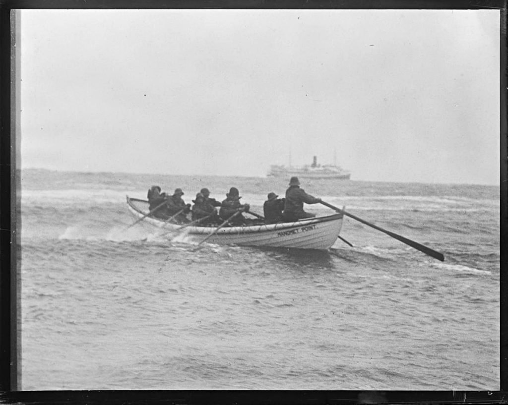Coast Guardsmen Row Toward SS Robert E. Lee
